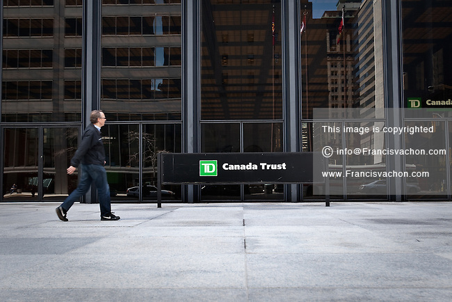 A man walks by a TD Canada Trust logo in Toronto financial district April 19, 2010. TD Canada Trust is the personal, small business and commercial banking operation of the Toronto-Dominion Bank (TD) in Canada.