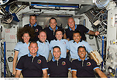 In Earth Orbit - March 24, 2009 -- STS-119 and Expedition 18 crewmembers pose for a group photo following a joint news conference in the Harmony node of the International Space Station while Space Shuttle Discovery remains docked with the station. From the left (bottom row) are NASA astronauts Tony Antonelli, STS-119 pilot; Lee Archambault, STS-119 commander; and Joseph Acaba, STS-119 mission specialist. From the left (middle row) are NASA astronauts Sandra Magnus, STS-119 mission specialist; and Michael Fincke, Expedition 18 commander; along with cosmonaut Yury Lonchakov and Japan Aerospace Exploration Agency astronaut (JAXA) Koichi Wakata, both Expedition 18 flight engineers. From the left (top row) are NASA astronauts Steve Swanson, Richard Arnold and John Phillips, all STS-119 mission specialists. Magnus, who joined the station's Expedition 18 crew in November 2008, is being replaced by Wakata, who arrived at the station with the STS-119 crew..Credit: NASA via CNP