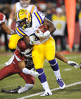 NWA Media/ANDY SHUPE - Arkansas' Alan Turner, left, reaches to bring down LSU's Darrel Williams during the second quarter Saturday, Nov. 15, 2014, at Razorback Stadium in Fayetteville.