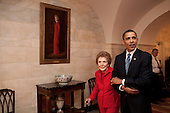 Washington, DC - June 2, 2009 -- United States President Barack Obama and former First Lady Nancy Reagan walk side-by-side through Center Hall in the White House, June 2, 2009. To the left of Mrs. Reagan hangs her official White House portrait as First Lady. &nbsp;<br /> Mandatory Credit: Pete Souza - White House via CNP