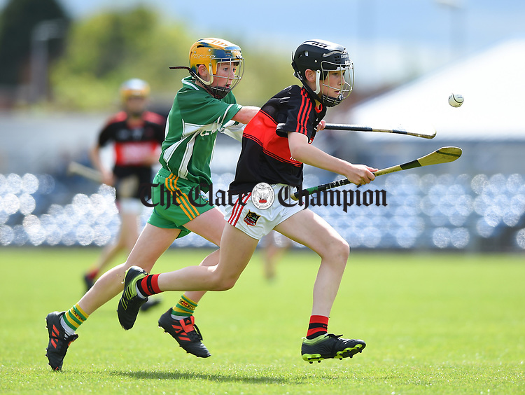 Neil Hegarty of Kilnamona in action against Harry Bogenberger of Mountshannon/Lackyle during their Schools Division 3 final at Cusack Park. Photograph by John Kelly