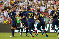 Landover, MD - July 23, 2019: Real Madrid players celebrate after a goal during the match between Arsenal and Real Madrid at FedEx Field in Landover, MD.   (Photo by Elliott Brown/Media Images International)