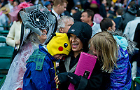 LOUISVILLE, KY - MAY 05: Fans hug each other on Kentucky Oaks Day at Churchill Downs on May 5, 2017 in Louisville, Kentucky. (Photo by Douglas DeFelice/Eclipse Sportswire/Getty Images)