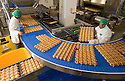 23/03/16<br /> <br /> ***FILE PHOTO***<br /> Hot cross buns being made for M&amp;S at Gunstones Bakery near Chesterfield, Derbyshire.<br />  <br /> M&amp;S prepares for bun fights at the tills as it expects to sell 1000 hot cross a minute.<br /> <br /> M&amp;S expects to sell 1000 hot cross buns a minute over the Easter bank holiday.<br /> <br /> The retailer sells a third of the nation&rsquo;s hot cross buns at Easter, and expects to sell over 30 million this Easter. <br /> <br /> The retailer&rsquo;s hot cross bun supplier is already in 24 hour production to meet customer demand.<br /> <br /> M&amp;S has its largest ever range of hot cross buns this year to excite customers taste buds.<br /> Over the Easter period thirty tons of flour and twenty tons of fruit are used to make a quarter of a million buns every day. <br />  <br /> M&amp;S will sell enough buns that if laid end-to-end, they'd stretch from the supplier in Sheffield to Nazareth.<br /> During Easter week the retailer will sell enough individual hot cross buns that if stacked could scale Mount Everest 14 times.<br />  <br />  <br /> <br /> All Rights Reserved: F Stop Press Ltd. +44(0)1335 418365   www.fstoppress.com.