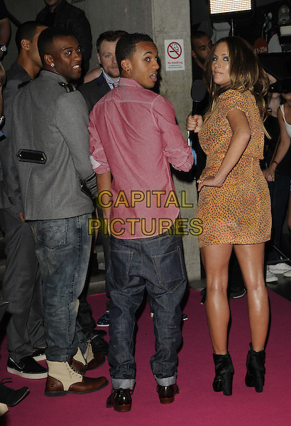 JB GILL, ASTON MERRYGOLD & CAROLINE FLACK.BT Digital Music Awards held at the Roundhouse, Chalk Farm, London, England..September 29th 2011.full length back behind rear looking over shoulder profile grey gray jacket red pink shirt orange yellow print dress jls.CAP/CAN.©Can Nguyen/Capital Pictures.