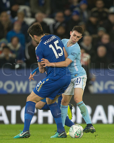 19th December 2017, King Power Stadium, Leicester, England; Carabao Cup quarter-final, Leicester City versus Manchester City; Phil Foden of Manchester City fouls Harry Maguire of Leicester City