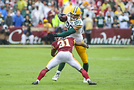 Landover, MD - September 23, 2018: Green Bay Packers tight end Jimmy Graham (80) is tackled by Washington Redskins cornerback Fabian Moreau (31) during the  game between Green Bay Packers and Washington Redskins at FedEx Field in Landover, MD.   (Photo by Elliott Brown/Media Images International)