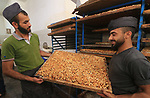 "Palestinians prepare sweet known in Arabic as ""Halkoum"" in a store to be sold ahead of the Eid al-Fitr holiday in Gaza city on May 30, 2019. Eid al-Fitr marks the end of Muslim's holy fasting month of Ramadan when faithfuls abstain from eating, drinking, smoking and sexual activities from dawn to dusk. Photo by Mahmoud Khattab"