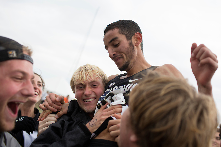 Colorado's Ammar Moussa (87) is lifted onto the shoulders of teammates after he finished fifth, helping secure the team's second-straight NCAA Division I Men's Cross Country National Title  in Terre Haute, Ind. on Saturday, Nov. 22, 2014. (James Brosher, Special to the Denver Post)