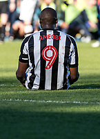 Shola Ameobi of Notts County sits on the deck before going off injured during the Sky Bet League 2 match between Wycombe Wanderers and Notts County at Adams Park, High Wycombe, England on the 25th March 2017. Photo by Liam McAvoy.