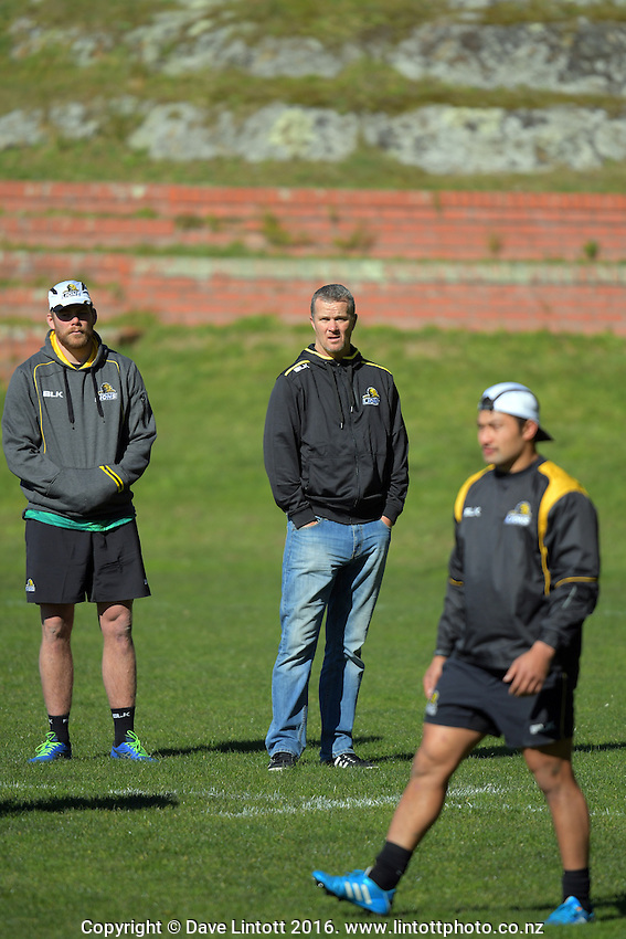 Mark Reddish (left) and assistant coach Richard Watt watch Greg Foe (right) during the Wellington Lions Mitre 10 Cup rugby union training at Rugby League Park, Wellington, New Zealand on Friday, 19 August 2016. Photo: Dave Lintott / lintottphoto.co.nz