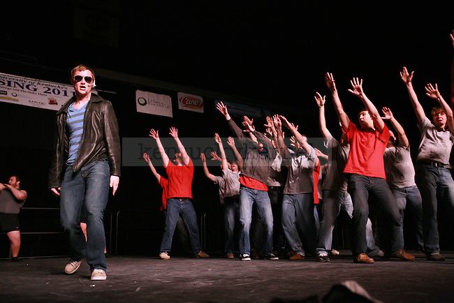 A Phi Sigma Kappa fraternity member dressed up as Justin Beiber for their act based on YouTube phenomenons, during their performance at the 2011 Greek Sing competition at Memorial Coliseum, Feb. 5, 2011. Photo by Kirsten Holliday | Staff