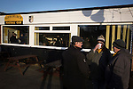 Three home supporters chatting outside the clubhouse at Lye Meadow before Alvechurch hosted Highgate United in a Midland Football League premier division match. Originally founded in 1929 and reformed in 1996 after going bust, the club has plans to move from their current historic ground to a new purpose-built stadium in time for the 2017-18 season. Alvechurch won this particular match by 3-0, watched by 178 spectators, taking them back to the top of the league.