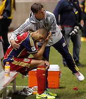 Alvaro Saborio #15 of Real Salt Lake is comforted by an assistant coach after they lost  to D.C. United at the U.S. Open Cup Final on October  1, 2013 at Rio Tinto Stadium in Sandy, Utah. DC United beat Real Salt Lake 1-0 to win the championship.