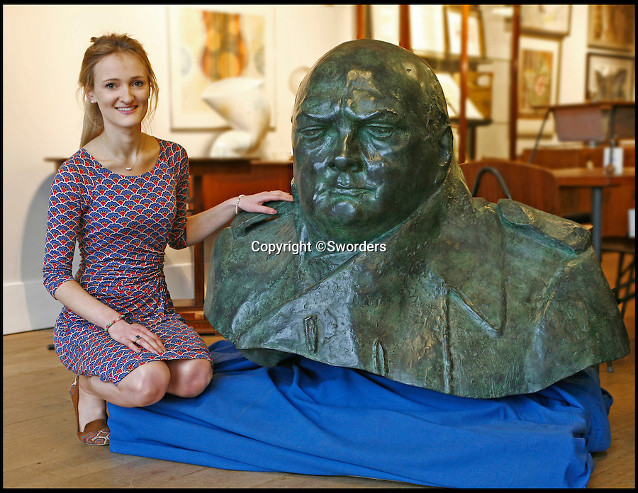 BNPS.co.uk (01202 558833)<br /> Pic: Sworders/BNPS<br /> <br /> Churchill cast with Sworders' junior photographer, Sylvia Ewen.<br /> <br /> This one tonne bronze bust modelled from an iconic statue of Winston Churchill would be quite the conversation piece - but would dominate most living rooms. <br /> <br /> The monumental mould captures the man voted the greatest ever Britain at his most defiant and stands nearly three feet tall, and is so large it takes four people to move it. <br /> <br /> It is one of only six authorised duplicates of the iconic Parliament Square sculpture of the wartime Prime Minister that will ever be made - with bidders from across the world set to fight it out for the  four feet wide piece.