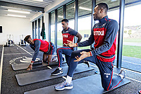 (L-R) Tammy Abraham, Luciano Narsingh and Jordan Ayew exercise in the gym during the Swansea City Training at The Fairwood Training Ground, Swansea, Wales, UK. Tuesday 13 March 2018