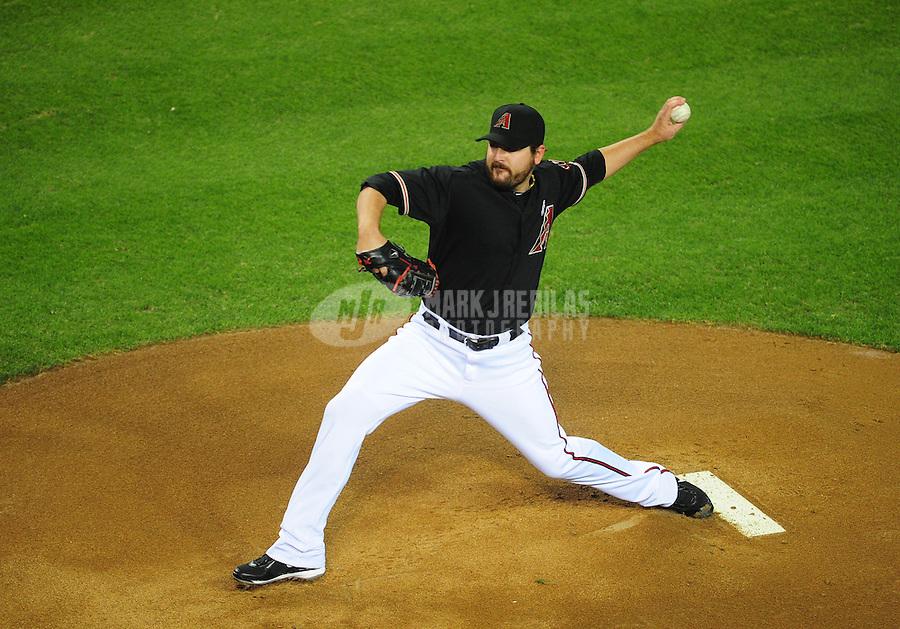 May 13, 2012; Phoenix, AZ, USA; Arizona Diamondbacks pitcher Joe Saunders throws in the first inning against the San Francisco Giants at Chase Field. Mandatory Credit: Mark J. Rebilas-