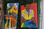 Paintings in the window of Lalosh silver/Le Jardin on Royal Street in the French Quarter, New Orleans, LA - April 2006