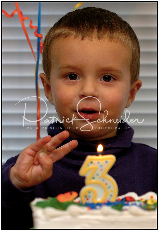 A boy shows his excitement at turning three. Photo is part of a series of several images taken one after another. Model released photo.