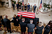 From center left, retired Associate Justice Anthony Kennedy, Ashley Kavanaugh, the wife of Associate Justice Brett Kavanaugh, Associate Justice Elena Kagan, Associate Justice Sonia Sotomayor, Associate Justice Samuel Alito, Associate Justice Ruth Bader Ginsburg, and Chief Justice John Roberts participates in a ceremony along with family, below, for the late Supreme Court Justice John Paul Stevens as he lies in repose in the Great Hall of the Supreme Court in Washington, Monday, July 22, 2019. <br /> Credit: Andrew Harnik / Pool via CNP