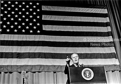 Before the flag of the United States of America, US President Gerald R. Ford makes remarks at a Republican fundraising dinner sponsored by the Greater Indianapolis (Indiana) Republican Finance Committee and the Marion County (Indiana) Republican Central Committee at the Indiana Convention-Exposition Center in Indianapolis, Indiana on October 16, 1974.<br /> Mandatory Credit: Ricardo Thomas / White House via CNP