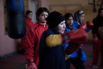 4 APRIL 2012, Kabul, Afghanistan:  Young women participate in boxing training at the Ghazi Olympic Stadium in Kabul that was formerly the site of public be-headings during the Taliban years. The girls have bucked the conservative elements of society to take part in training and are aiming to compete at the elite level of the sports at the Olympic Games. Picture by Graham Crouch/The Australian
