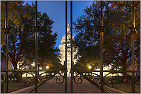 South Congress Avenue ends at the gates of the state capitol in Austin, Texas. This photograph shows the view looking through the Lone Star studded bars at the house of the state government on an early Autumn morning.
