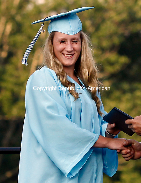 Oxford, CT- 17 June 2014-061714CM14-  Oxford High School graduate Taylor Drayton receives her diploma during commencement exercises at Oxford High School on Tuesday.    Christopher Massa Republican-American