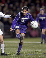 "University of Washington midfielder Jane Mitchell (12) clears the ball. In overtime, Boston College defeated University of Washington, 1-0, in NCAA tournament ""Elite 8"" match at Newton Soccer Field, Newton, MA, on November 27, 2010."