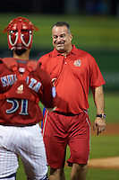 Clearwater Threshers alumni Dominic DeSantis shakes hands with catcher Chace Numata (51) after throwing out the ceremonial first pitch before the second game of a doubleheader against the Jupiter Hammerheads on July 25, 2015 at Bright House Field in Clearwater, Florida.  Clearwater defeated Jupiter 2-1.  (Mike Janes/Four Seam Images)
