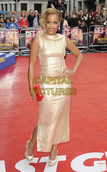 Lorraine Burroughs.The 'Fast Girls' UK film premiere, Odeon West End cinema, Leicester Square, London, England..June 7th, 2012.full length gold silk satin red clutch bag  sleeveless dress hand on hip  .CAP/CAN.©Can Nguyen/Capital Pictures.