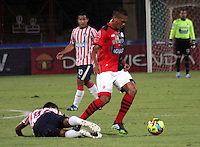 CÚCUTA -COLOMBIA, 21-08-2013.  Un jugador del Cucuta Deportivo (Der.) disputa el balón con Luis Carlos Ruiz (Izq.) del Junior, durante partido por la fecha 5 de la Liga Postobon II disputado en el estadio General Santander de la ciudad de Cucuta./  Cucuta Deportivo player fights for the ball with Junior player Luis carlos Ruiz (L) during match valid for the fifth date of the Postobon League II at the General Santander Stadium in Cucuta city. Photo: VizzorImage/Manuel Hernandez/STR