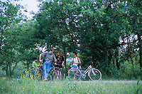 Group of friends taking a break after cycling through the countryside, Bras, Provence, France.