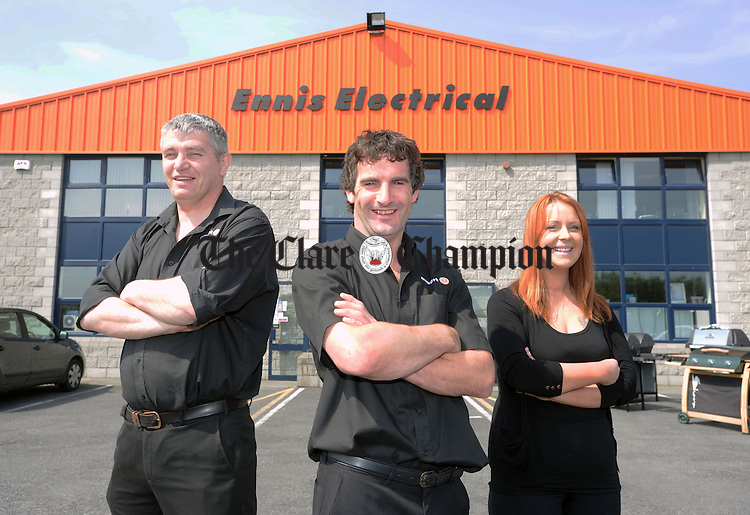 Eric Flynn (centre), store manager, with sales staff Cyril Kelly and Suzanne Carnochan.