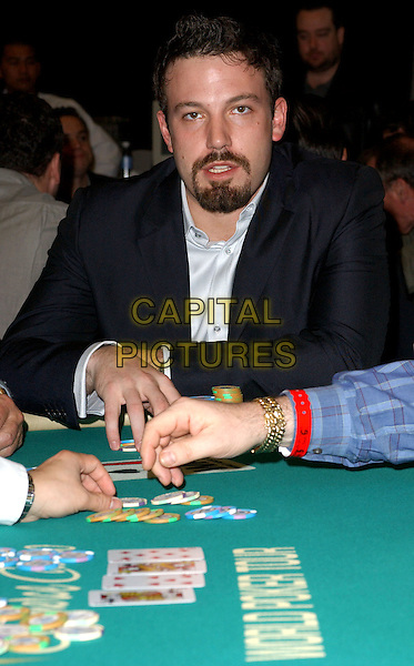 BEN AFFLECK.participates at the World Poker Tour Invitational held at The  Commerce Casino in Commerce, California                    25 February 2004.*UK Sales Only*.playing cards.www.capitalpictures.com.sales@capitalpictures.com.©Capital Pictures.
