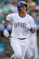 Round Rock Express outfielder Leonys Martin #40 heads to first during a game against the New Orleans Zephyrs at the Dell Diamond on July 21, 2011 in Round Rock, Texas.  New Orleans defeated Round Rock 7-4.  (Andrew Woolley/Four Seam Images)