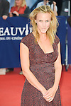 """Marie Kremer poses on the red carpet before the screening of the film """"The Man from U.N.C.L.E."""" during the 41st Deauville American Film Festival on September 11, 2015 in Deauville, France"""