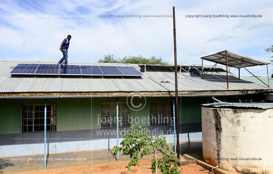 UGANDA, Karamoja, Loyoro village, installation of solar panels