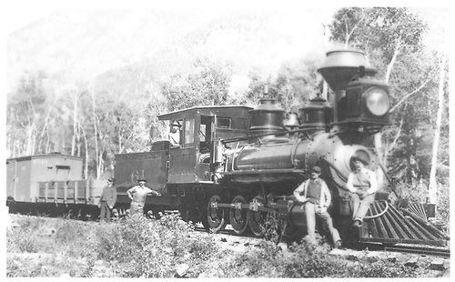 3/4 view of engine #61 &quot;La Jara&quot; with several men posing by engine and one in cab.  Pulling gondola and box car 4510.<br /> D&amp;RG