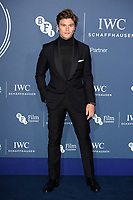 LONDON, UK. October 09, 2018: Oliver Cheshire arriving for the 2018 IWC Schaffhausen Gala Dinner in Honour of the BFI at the Electric Light Station, London.<br /> Picture: Steve Vas/Featureflash