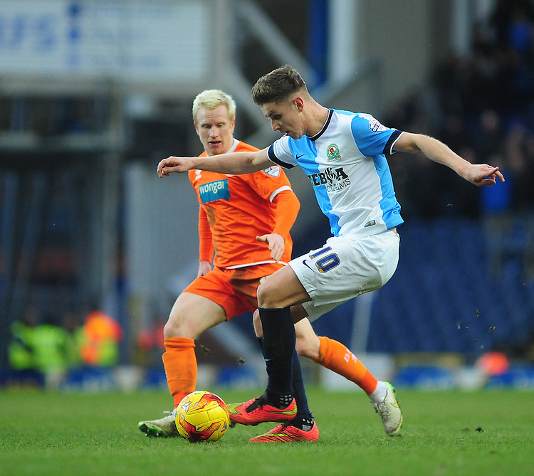 Blackburn Rovers' Tom Cairney shields the ball from Blackpool's David Perkins<br /> <br /> Photographer Chris Vaughan/CameraSport<br /> <br /> Football - The Football League Sky Bet Championship - Blackburn Rovers v Blackpool - Saturday 21st February 2015 - Ewood Park - Blackburn<br /> <br /> &copy; CameraSport - 43 Linden Ave. Countesthorpe. Leicester. England. LE8 5PG - Tel: +44 (0) 116 277 4147 - admin@camerasport.com - www.camerasport.com