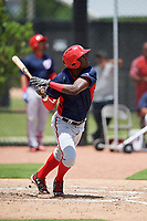GCL Nationals center fielder Caldioli Sanfler (9) follows through on a swing during a game against the GCL Astros on August 6, 2018 at FITTEAM Ballpark of the Palm Beaches in West Palm Beach, Florida.  GCL Astros defeated GCL Nationals 3-0.  (Mike Janes/Four Seam Images)