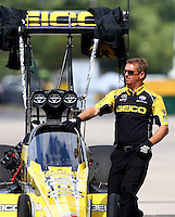 Sep 28, 2013; Madison, IL, USA; A crew member for NHRA top fuel dragster driver Morgan Lucas during qualifying for the Midwest Nationals at Gateway Motorsports Park. Mandatory Credit: Mark J. Rebilas-