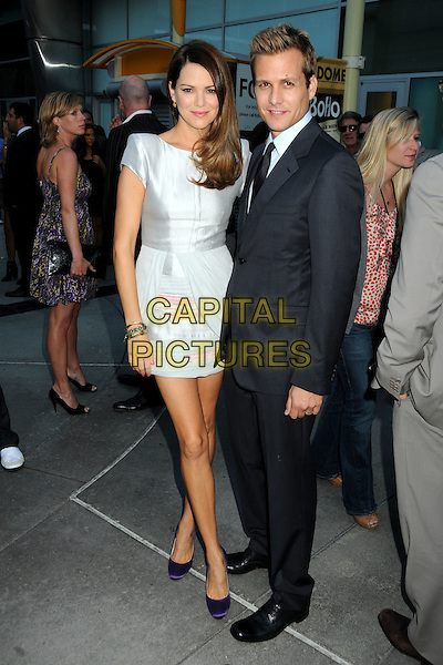 "JACINA BARRETT & GABRIEL MACHT .""Middle Men"" Los Angeles Premiere held at Arclight Cinemas, Hollywood, California, USA, 5th August 2010..full length silver grey gray dress black tie suit purple shoes .CAP/ADM/BP.©Byron Purvis/AdMedia/Capital Pictures."