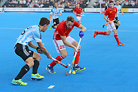 England's Chris Griffiths wins the ball from Argentina's Ignacio Ortiz during the Hockey World League Semi-Final match between England and Argentina at the Olympic Park, London, England on 18 June 2017. Photo by Steve McCarthy.