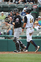 Erie Sea Wolves catcher Craig Albernaz (1) tags out Trenton Thunder base runner Rob Refsnyder (24) during game against played at ARM & HAMMER Park on May 15, 2014 in Trenton, NJ.  Erie defeated Trenton 4-2.  (Tomasso DeRosa/Four Seam Images)