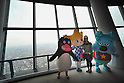 October 30, 2011, Tokyo, Japan - Masot characters welcome the media to the main observation deck of Tokyo Sky Tree on Sunday, October 30, 2011. The main observation deck of the terrestrial digital broadcasting tower was for the first time opened to the media. The three-story structure at 350 meters above the ground houses a restaurant, souvenir shop and an observation deck on the top floor. The tower begins its operation on May 22, 2012. (Photo by Natsuki Sakai/AFLO) [3615] -mis-