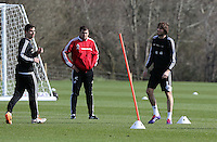 Pictured: Michu (R) with Jordi Amat (L) and coach Pep (C). Saturday 08 March 2014<br /> Re: Swansea City FC training at the Fairwood Training ground in the outskirts of Swansea, south Wales.