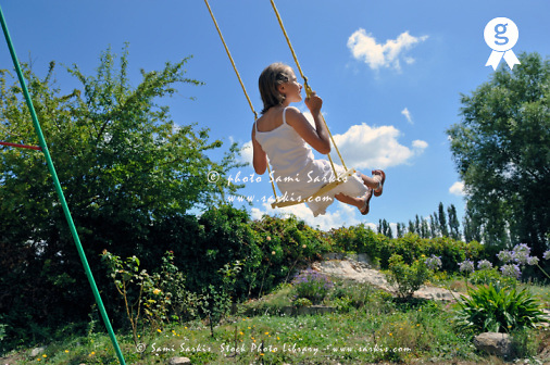Girl (9) swinging in garden (Licence this image exclusively with Getty: http://www.gettyimages.com/detail/92351855 )