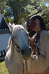 A Native American Indian man whispering to his horse